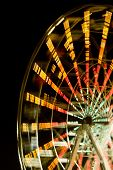 stock photo of ferris-wheel  - Ferris wheel at night with a motion blur - JPG