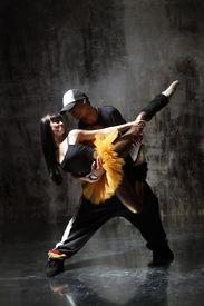 stock photo of ballet dancer  - modern style dancer posing on dirty grunge background - JPG