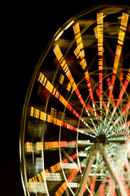stock photo of ferris-wheel  - Ferris wheel at night with a motion blur - JPG