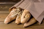 Tasty Crusty Baguettes Craft Bag Wooden Background Tasty Homemade Bread Horizontal poster