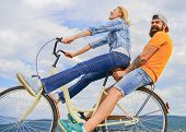 Man And Woman Rent Bike To Discover City. Bike Rental Or Bike Hire For Short Periods Of Time. Couple poster