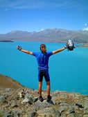 man excited at view over lake tekapo, new zealand