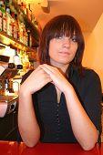 pretty waitress behind the bar