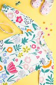 Little Girl Clothing And Accessories - Pretty Dress, Sandals, Sunglasses. Baby Summer Fashion Concep poster