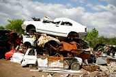 Cars piled on top of each other in junkyard