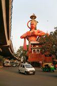 DELHI - FEBRUARY 24. Hanuman rising above street and metro flyover on February 24, 2008 in Delhi, India. This temple has survived the onslaught of urbanism and pollution.