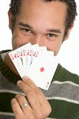 foto of playing card  - Young African American man holding straight flush - JPG