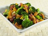 image of cruciferous  - Broccoli salad with bacon raisins cashews mandarin oranges cheddar cheese red onion and a sweet mayonnaise dressing - JPG