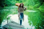 Beautiful hippie girl posing outdoor. Contemporary bohemian style. Spirit of freedom. Fashion shot.  poster