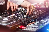 Closeup Hands Of Dj At The Control Panel Wearing In White Shirt. Disc Jockey Playing On The Professi poster