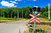 Railroad Crossing Sign And Semaphore In Front Of Railroad Crossing poster