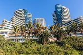 Beach Ocean  Coastline Landscape With Flat Apartment Buildings Holiday Lifestyle  Coastline Landscap poster