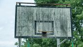 Old Wooden Basketball Shield On The City Sports Field. A Faded Shabby Basketball Court For Playing S poster