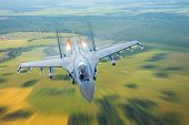 Постер, плакат: Combat Fighter Jet On A Military Mission With Weapons Rockets Bombs Weapons On Wings At High Sp