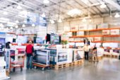Filtered Tone Blurry Background Customer Shopping With Flatbed Cart For Big Screen Tvs poster