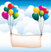 balloons and banner in the sky