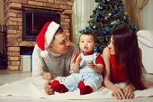 Family Celebrating Christmas On Background Of The Christmas Tree poster