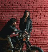 Pickup A Girl. Bearded Man On Bike Pickup A Girl On Red Brick Wall Background. Biker Pickup A Girl I poster