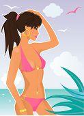 Постер, плакат: Красивая женщина в розовом бикини на пляже