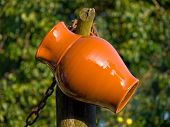 stock photo of loamy  - Ceramic jug on the tree in a village - JPG