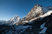 picture of cho-cho  - Cho La pass peaks at dawn in Himalaya mountains. Hiling in Nepal ** Note: Slight blurriness, best at smaller sizes - JPG