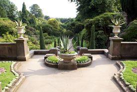 stock photo of garden-art  - Garden landscape. Garden art. Garden design. Garden decorative path or entry with vases. ** Note: Slight blurriness, best at smaller sizes - JPG