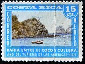 A stamp dedicated to the year of tourism in the Americas shows the Bay between the coconut and snake