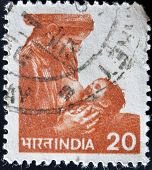 INDIA - CIRCA 1984: A stamp printed in India shows woman breast-feeds the baby circa 1984