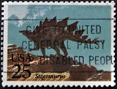 A stamp printed in USA shows a stegosaurus