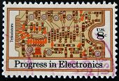 stamp printed in USA shows transistors and printed circuit board
