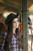 foto of horse-riders  - Attractive girl with cowboy hat in horse ranch - JPG