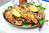 Grilled Fish With Greens On The Plate