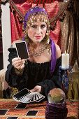 foto of palm-reading  - Pretty Romani woman dealing blank tarot cards - JPG