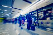 picture of passenger train  - passengers motion blur in shenzhen train station waiting hall - JPG