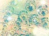 Many disco balls on ceiling in a nightclub