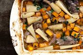 Slow-cooked lamb casserole with squash and parsnips.