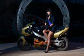 girl sitting on a motorcycle at night
