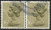 UK-por volta de 1983: um selo imprimido no Reino Unido mostra imagem de Elizabeth II é o monarca constitucional de 16
