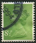 UK-CIRCA 1975: A stamp printed in UK shows image of Elizabeth II is the constitutional monarch of 16