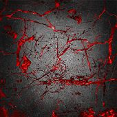 picture of gory  - Grunge cracked concrete with gory red background underneath - JPG