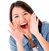 Happy woman shouting - isolated over a white background