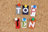 stock photo of ten  - The words Top Ten in cut out magazine letters pinned to a cork notice board - JPG