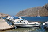 SYMI, GREECE - JUNE 25: Small boats moored in Pedi harbour on June 25, 2011 on the Greek island of S