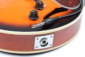 Color photo of mandolin and plug