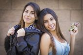 Two Beautiful Mixed Race Twin Sisters Portrait Outdoors.