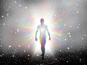 stock photo of cosmic  - Man in rainbow light and stars - JPG