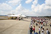 ZHUKOVSKY - AUGUST 12: Airplane Valentine Blyznyuk and spectators on airshow devoted to 100 annivers