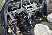 Disassembled console in car at checkout - lot of multicolored wires.