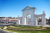 Arch Puerta de San Vicente at sunny spring day in Madrid, Spain.