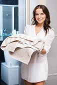 indoor picture of perfect housewife with towels.